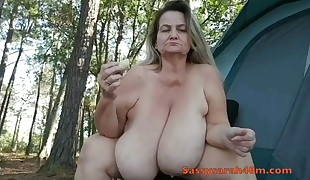 Big saggy bra-stuffers lady with a banana