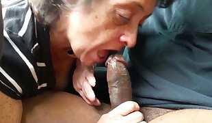 Granny gives a head &, swallow on black cock.